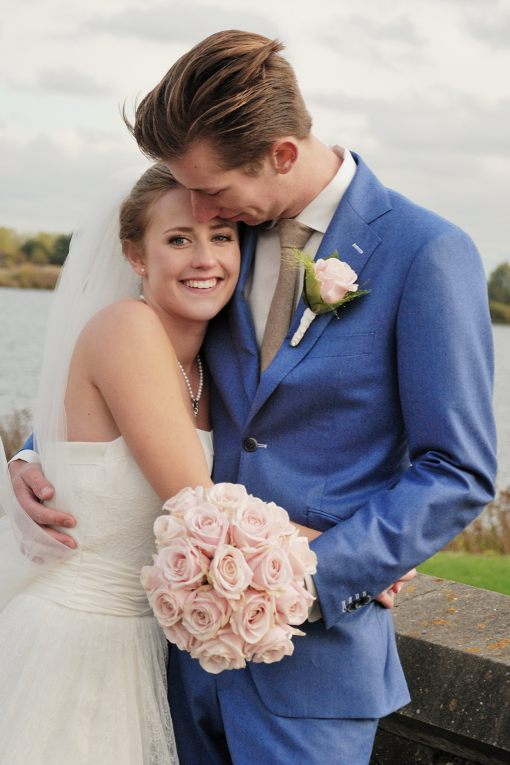 Couple hugging on their wedding in Holland
